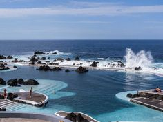 Madeira Islands, Portugal. There are natural lava pools all over Madeira Island. The baths at Porto Moniz are a series of gorgeous natural pools that seem to blend rig...