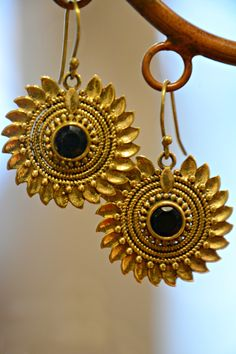 Our Fair Trade Radiant Sunflower Earrings will add a punch of flower power to your outfit. A take on the traditional intricate metal work and mandala motifs found in Indian jewelry, with a faceted bla