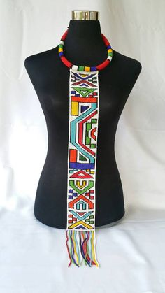 Handmade Ndebele beeded necktie that can be worn by both sexes African Tribal Jewelry, African Beads Necklace, Beaded Necklace Patterns, Beading Patterns, Zulu Traditional Attire, Traditional Dresses, Navratri Dress, African Fashion, African Beauty