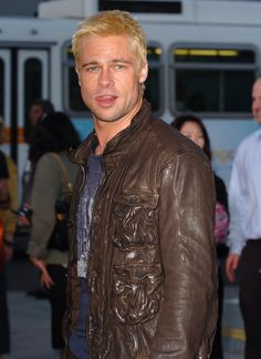 "Pin for Later: 52 Years of Epic Brad Pitt Hotness A bleach-blond Brad said ""hey, girl"" to the crowd as he arrived for the LA premiere of Mr. Smith back in June Brad And Jennifer, Brad And Angelina, Brad Pitt Age, Holy Shirt, Hipster Haircut, Spike Tv, The Emmys, How To Look Handsome, Film Awards"