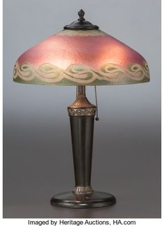 Art Glass, AMERICAN PAINTED GLASS AND METAL TABLE LAMP. Circa 1915. 20 incheshigh x 14 inches diameter of shade (50.8 x 35.6 cm). ...