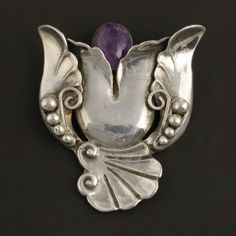 Brooch | Los Castillo. Sterling Silver & Amethyst.  ca. 1940s...I think he was a fan of Georg Jensen!