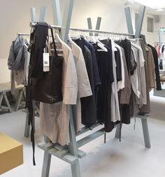 Great idea for hanging clothes where no closet exists. 2x4s and a rod.