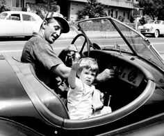 Robert Mitchum takes daughter Petrine for a ride, around  1955.