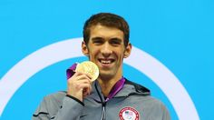 Gold medallist Michael Phelps of the USA poses on the podium: 21 Olympic medals... 17 Gold