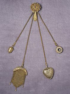 "A Composed Chatelaine    Basically tool kits masquerading as jewelry, ""chatelaines"" allowed Victorian women to keep quotidian essentials at the ready, in the graceful style the era demanded. Consisting of functional pendants attached to a clip, these accessories were worn at the waist."