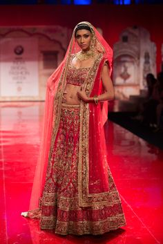 Dark pink and gold Indian bridal wedding lehnga with dupatta by Suneet Varma. More here: http://www.indianweddingsite.com/bmw-india-bridal-fashion-week-ibfw-2014-suneet-varma/