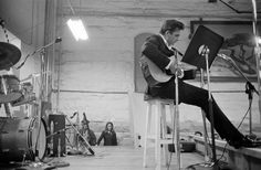 Johnny Cash, with June Carter coming onstage, Folsom State Prison, Folsom,  Calif., Jan. 13, 1968. (Jim Marshall Photography LLC, courtesy of Steven Kasher Gallery, New York)