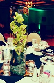 Tall Wedding Centerpiece  Orchids   filled with water with 3 inch floating candle in top