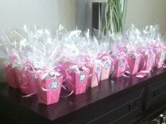 DIY Party Favor Holders made from Card stock, filled with treats, and wrapped in cellophane.