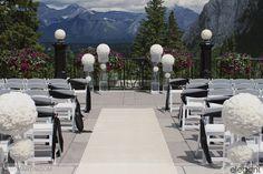 Sunning floral pedestals for wedding ceremony. Wedding flowers, white wedding flowers, ceremony flowers, Banff wedding vista.