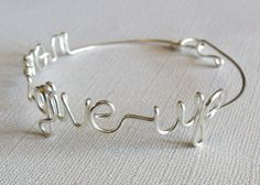 Never Give Up Wire Script Bangle by wirewrap on Etsy