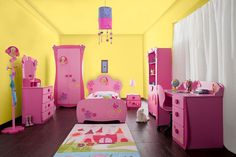 I like the contrast of the yellow walls with the pink furniture - girl's bedroom