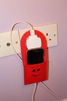 A great way to charge your cell phone without laying it down on the counter or floor. The grommet sits on top of the charger and the phone and the