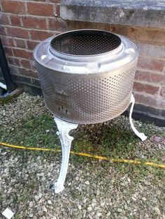 Washing machine drum fire pit with bistro chair legs. Made by us :)