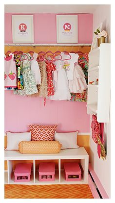 In a small nursery with no closet exposed shelving & hanging is a great storage solution - plus it will force you to edit your child's wardrobe frequently.