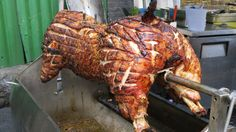 London Street Food. Whole Pig Roasting for Sandwiches. Seen in Borough M...