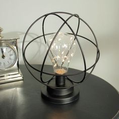 Atom Light Bulb LED Lamp Made from metal in black This unique lamp is battery operated With a large bulb filled with LED lights Requires x 2 AA batteries £17.95 www.melodymaison.co.uk