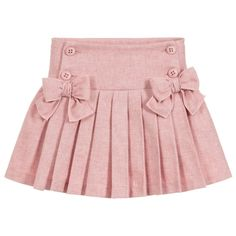 A pretty pink skirt for girls by Balloon Chic, made in soft flannel. It has button fastening on the dropped waist with adjustable elastic inside for a comfortable fit. The skirt is gathered on the back and pleated on the front with two sweet bows. Little Girl Skirts, Skirts For Kids, Little Girl Dresses, Frocks For Girls, Kids Dress Wear, Kids Wear, Bow Skirt, Pleated Skirt, Toddler Skirt