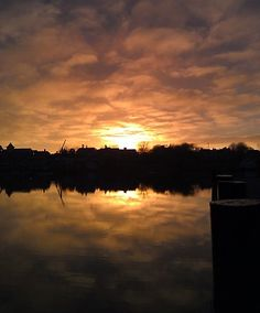 The winter sun setting over Wychmere Harbor in Harwich. Photo by John Fitts. Winter Sun, Travel Information, Cape Cod, Places To Visit, Island, Sunset, Outdoor, Cod, Outdoors