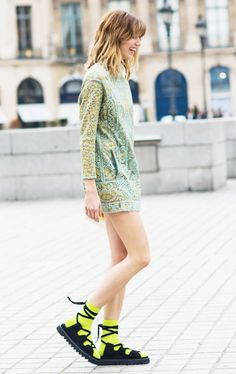 Style a feminine lacy dress with surprisingly bright socks and chunky sandals.