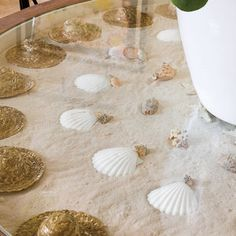 """""""On the beach, you find all sorts of treasures, so I liked the idea of a dining table that doubles as an artsy display cabinet—like those you'd see in Victorian times. We had this one made locally and filled it with sand, shells, and mini straw hats."""""""