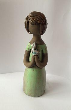 60s ceramic figurine statue / girl holding a bird/ Handmade Elbogen / Sweden Scandinavia by PotsAndLamps on Etsy