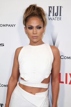 J-Lo's 60's siren ponytail and smokey eyes at the Golden Globes afterparty. Smokin'