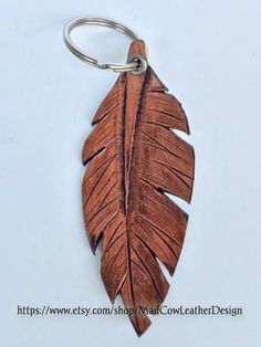 GO FOLLOW MY NIECE LiAnne AND HER CREATIVE LEATHER WORKS!!!!   Leather Feather Keychain https://www.etsy.com/shop/MadCowLeatherDesign Design tooled leather leather design keychain feather feather keychain leather feather