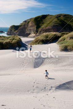 Man & Child on Sand Dunes, Wharariki Beach, NZ Royalty Free Stock Photo Kiwiana, Man Child, New Zealand Travel, Travel And Tourism, Image Now, Dune, National Parks, Scenery, Royalty Free Stock Photos
