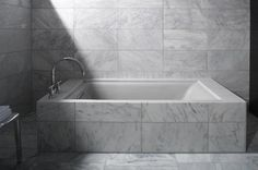 Kohler purity tub - undermount bath with marble deck/surround, but we would use marble slab not tiles.
