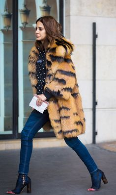 Don't let winter stand in the way of looking cute at your next concert. Get seven stylish, seasonal outfit ideas here.