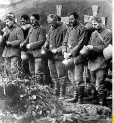 WWI, 1916/17; Members of a Rhine Regiment at the funeral of fallen comrades. Credit; AKG Images/Ullstein Bild