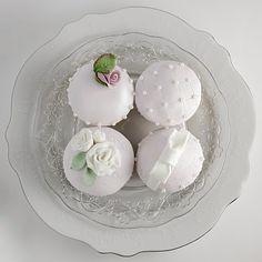 Elegant white fondant cupcakes