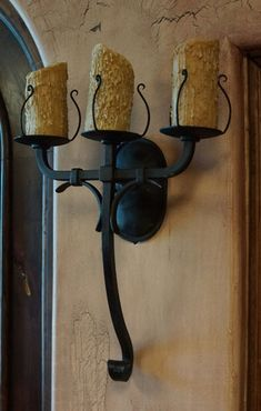 The Vallejo Sconces are classic, triple iron sconces featuring a smooth, black iron finish and simple scrolled design. Rustic Iron Candle Wall Sconces.