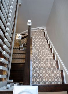 Patterned carpet with bare walls make the stairs look so very interesting.