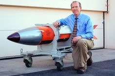 Controversial New U.S. Nuclear Bomb Moves Closer to Full-Scale Production - Aug 23, 2016 -  Phil Hoover, engineer and manager of the B61-12 integration project, kneels next to flight-test body of a B61-12 nuclear weapon at the Sandia National Laboratories in Albuquerque, New Mexico on April 2, 2015. The flight-test body is a semi-operational copy of an actual B61-12 but without the physics package (nuclear bomb) or functional tail fins, and is used to test the weapon on an aircraft.
