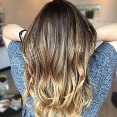 wavy brown hair with blonde balayage