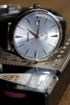 """Seiko SARB 065 """"Cocktail Time"""". Deployment clasp buckle w/blue stitching on the band. Exhibition case back. (<$500)."""