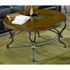 5553 Series Round Coffee Table with Curved Metal Base by Woodbridge Home Designs. $368.99. Single round coffee table.. Etched center motif.. Featuring the look of leather on edge banding.. Curved metal base.. Dimensions: 39.5Dia x 20H.. 5553-01 Features: -Cocktail table.-Round wooden top.-Metal side curvings. Dimensions: -Overall Dimensions: 20'' H x 39.5'' W x 39.5'' D.