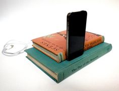 This clever Etsy seller turns old books into iPhone charging stations. Get one for your desk!!