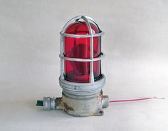 Industrial Red Glass Explosion Proof Light Sconce. $49.95, via Etsy.