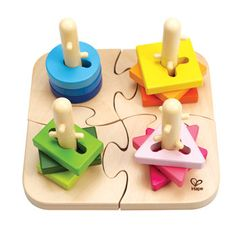 With the Creative Peg Puzzle from Hape kids join puzzle pieces together and then twist the shapes to fit on the appropriate posts. Stacking, sorting and puzzle game. Includes 12 colorful wooden pieces and 4 base puzzle pieces. Wooden Pegs, Wooden Puzzles, Toddler Toys, Kids Toys, Puzzles Für Kinder, Hape Toys, Special Needs Toys, Puzzles For Toddlers, Wooden Toys For Toddlers