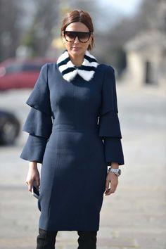 Roksanda Ilincic dress, Louis Vuitton fur neckpiece, Gianvitto Rossi boots, Celine sunglasses, Dior Homme watch.