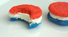 These are just simple sugar cookie recipe: one batch with a little blue dye and the other with some red. White frosting in the middle ^_^