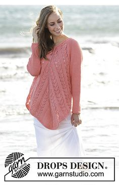 Knitted tunic with lace pattern, worked top down in DROPS Paris. Size: S - XXXL