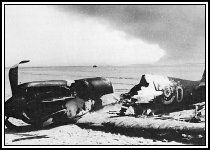 The remains of a Spitfire on a beach near Dunkirk-Tuesday August 13th 1940  Adler Tag (Eagle Day) Begins-cities, factories and the rail network became the target of the German night bombers. The Short Brothers aircraft factory in Belfast in Ireland, and at Castle Bromwich where the new Spitfire Mk II was being produced and other targets were: Aberdeen in Scotland, Liverpool in north west England and Swansea in Wales all became targets