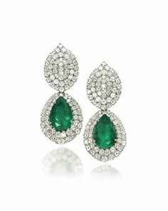 A PAIR OF EMERALD AND DIAMOND EARRINGS  Each with a diamond-set pear-shaped top suspending a detachable pendant centering upon a pear-shaped emerald in a brilliant-cut diamond surround, mounted in gold, 6.3 cm