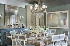 In an Alexa Hampton–designed Connecticut home, the dining room features a reclaimed-elm pedestal table from Mecox and a silver-leafed ceiling; the mirrored sideboard and silver candlesticks are from John Rosselli Antiques. Alexa Hampton, Architectural Digest, Dining Room Design, Dining Room Table, Dining Rooms, Dining Chairs, Bed Table, Mirrored Sideboard, Architecture