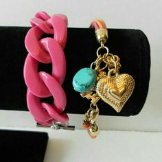 """Gold & pink charm bracelet set NWT Trendy and fun bracelet set. One chunky pink plastic link bracelet with a toggle clasp closure and one pink.amd orange corded charm bracelet with a lobster clasp closure. Fits wrist 6 to 7.5"""". Brand new with tag. Jill Marie Boutique Jewelry Bracelets"""